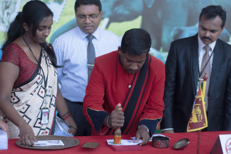 """The event also witnessed the launch of the """"Top Seven Wild Sri Lanka"""" series of stamps. Seen here is the issuing of the first day issue of stamps to commemorate the ceremony."""