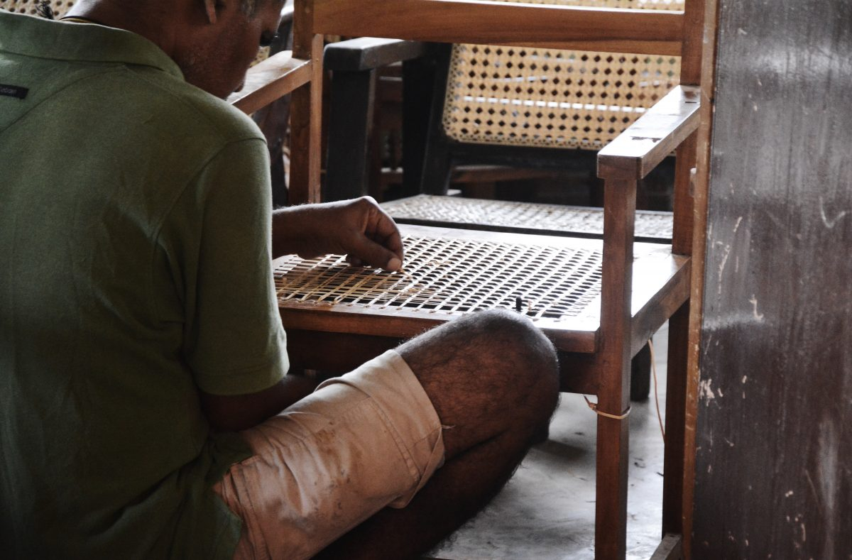 A patient mends a cane chair as part of his occupational therapy. Much of the furniture sent here to be mended belong to the wards, and this is another example of the patients being trained to look after themselves. Image credit: Roar.lk/Minaali Haputantri